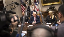 From left: Indiana Attorney General Curtis Hill, President Donald Trump and Florida Attorney General Pam Bondi during a meeting with state and local officials on school safety inside the Roosevelt Room of the White House Thursday.