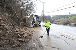 In this March 1, 2018, file photo, workers remove debris after a landslide along Forward Avenue in Squirrel Hill.
