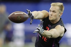 Penn State tight end Mike Gesicki runs a drill during the NFL football scouting combine in March.