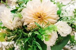 Arrangement by Greensinner features dahlia and lisianthus.