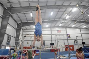 Elena Burek, 17, of Glenshaw practices on an Uneven bars at Jewart's Gymnastics on Tuesday, March 6, 2018 in Hampton Township.