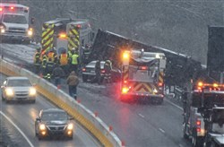 Emergency crews at the scene of the Tuesday morning fatal chain-reaction crash on the Parkway North in Ross.