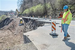 Workers clear the section of Route 30 in East Pittsburgh that was destroyed April 7 by a landslide in East Pittsburgh.