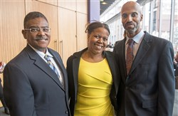 From left, Board chair Vincent Johnson, awardee Shimira Williams, and CEO Darryl T. Wiley.