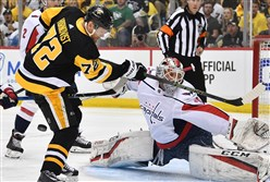 Captals' goalie Braden Holtby makes a save on Pittsburgh Penguins' Patric Hornqvist in the first period in Game 4 of the second-round playoff series Thursday night at PPG Paints Arena.