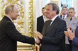 Best buds: Vladimir Putin with former German Chancellor Gerhard Schroeder at the Russian leader's May 7 inauguration after his amazing election victory.