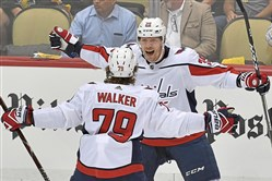 The Capitals' Nathan Walker congratulates Alex Chiasson on his goal against the Penguins in the second period of Game 6.