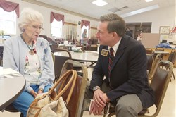 Bob Solomon talks with a voter at Burgettstown Senior Center on Monday.