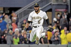 Pirates center fielder Starling Marte takes a victory leap after defeating the Giants May 11.