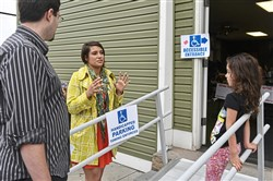 Democrat Sara Innamorato speaks with Ben Adams and his daughter Carina Adams, 6, outside of her polling place Tuesday, May, 15, 2018, in Lawrenceville.