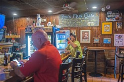 John Shrader, right, 21, of Washington, Pa., has a beer after work at Peter's Pub on Thursday, May 17, 2018 in Oakland. Peter's Pub in Oakland is closing next Friday after 46 years in business.