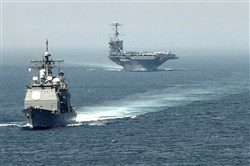 The guided-missile cruiser USS Gettysburg, left, and aircraft carrier USS Harry S. Truman.
