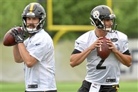 Steelers quarterbacks Landry Jones and Mason Rudolph drop back to pass during OTAs Wednesday on the South Side.