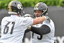 Steelers guard Ramon Foster goes through drills with offensive tackle Larson Graham during OTAs Wednesday.