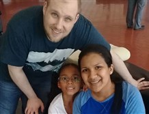 Joshua Holt poses for a photo with his wife Thamara and her daughter Marian Leal, at the airport in Caracas, Venezuela, Saturday.