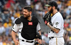 Pirates catcher Francisco Cervelli visits the mound after pitcher Trevor Williams hit Cardinals right fielder Dexter Fowler Saturday.