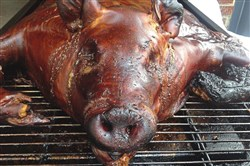 A pig is roasted at last year's Father's Day Pig Roast at Wigle Whiskey's North Side location. This year's event is on Sunday.
