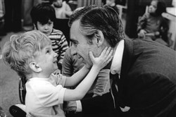 "Fred Rogers meets with a disabled boy in the film ""Won't You Be My Neighbor?"", a Focus Features release."