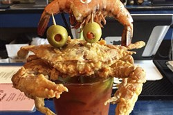 Luke Wholey's Wild Alaskan Grille will feature a bloody mary garnished with a soft shell crab that has green olives for eyes.