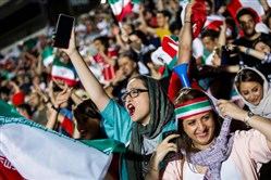 Iranian football supporters wave their national flags as they cheer for their national team during a screening of the World Cup match between Iran and Spain in Azadi Stadium in the capital Tehran on June 20, 2018.