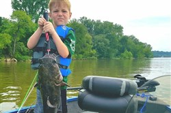 Veteran angler Finn Baker, 6, of Canonsburg, caught his first flathead catfish June 3 on the Ohio River. He also landed a smallmouth, sauger and channel cat.