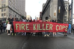 Protesters block the corner of Liberty Avenue and Sixth Street, Downtown, during a protest Friday against the shooting death of 17-year-old Antwon Rose.