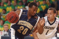 Pitt guard Brandin Knight drives the lane against Notre Dame in 2003.