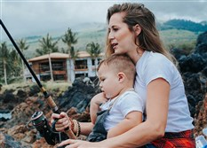 Actor and Recreational Boating and Fishing Federation spokeswoman Alexa PenaVega fishing with her 1 1/2-year-old son Ocean.