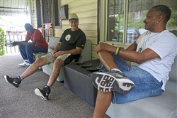 Veterans Hugh Walker, left, Dave Matta, center, and Kenneth Williams talk on the porch of their Homewood home on Friday.