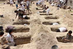 Yemenis dig graves for children, who where killed when their bus was hit during a Saudi-led coalition air strike that targeted the Dahyan market the previous day.
