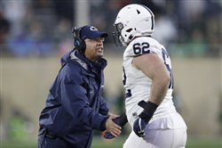 Penn State coach James Franklin greets offensive lineman during last year's game at Michigan State.