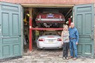 Cecile and Carl Canales stand by their North Side carriage house, one of 10 stops on the third Alleys, Axles and Ales tour on Sept. 29. Behind them is a 1960 Jaguar Mark IX, top, and 2007 XK Jaguar convertible.