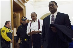Bill Cosby, center, leaves the courtroom after he was sentenced to three-to 10-years for felony sexual assault on Tuesday, Sept. 25, 2018, in Norristown, Pa.