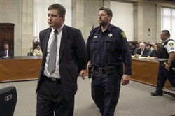 Chicago police Officer Jason Van Dyke, left, is taken into custody after jurors last week found him guilty of second-degree murder and aggravated battery in the 2014 shooting of black teenager Laquan McDonald.