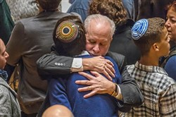 Rabbi Jeffrey Myers, of Tree of Life Congregation, hugs a congregant after thousands gathered for a vigil to remember the victims of the mass shooting at the Tree of Life synagogue, Sunday, Oct. 28, 2018, at Soldiers & Sailors Memorial Hall and Museum in Oakland.