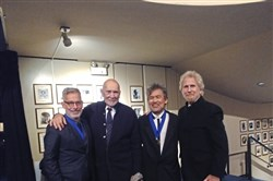 From left, Joe Mantello, Frank Langella, David Henry Hwang and Rene Auberjonois gather under their names on the walls of the Theater Hall of Fame at the Gershwin Theatre in New York on Monday, Nov. 12.