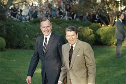 President Ronald Reagan greets President-elect George H.W. Bush at the White House Nov. 10, 1988.