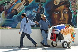 A popcorn vendor in Los Angeles greets a passerby.