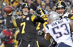 Steelers quarterback Ben Roethlisberger drops back to pass against the Patriots in the first half Sunday, Dec. 16, 2018, at Heinz Field.