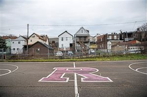 A basketball court which was remodeled by Triton Industries, Thursday Nov. 29, 2018, on Railroad Way in Rankin. (Michael M. Santiago/Post-Gazette) #childpoverty2019