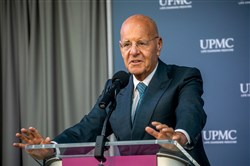 President and CEO Jeffrey Romoff speaks during a  groundbreaking ceremony on the site of the new UPMC Vision and Rehabilitation Tower at UPMC Mercy on March 14.