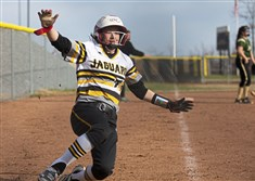 Freshman Graci Fairman, 2, scores as she slides into home plate during the varsity girls softball game between the Belle Vernon Leopards and the Thomas Jefferson Jaguars Tuesday, April 2, 2019, at Thomas Jefferson High School in Clairton.
