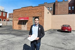 Matthew Falcone, president of Preservation Pittsburgh, stands on the former site of Beth Israel Synagogue Wednesday April 10, 2019, on East Street on the North Side.