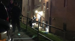 Police investigate the scene of a shooting late Wednesday night outside a Spring Hill apartment.