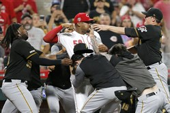 Reds reliever Amir Garrett tries to fight the entire Pirates bench at Great American Ball Park last month.