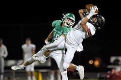 South Fayette's Ryan McGuire (18) tackles Upper St. Clair's Ben Lund (17) as he catches a pass during the season opener game between Upper St. Clair and South Fayette at South Fayette High School, Friday, Aug. 23, 2019, in South Fayette.