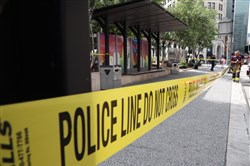 Police tape blocks off Triangle Park in Downtown Pittsburgh where a woman was stabbed Friday afternoon.