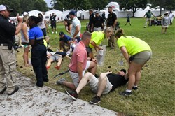 Spectators are tended to after a lightning strike on the golf course left several injured during a weather delay in the third round of the Tour Championship golf tournament Saturday, Aug. 24, 2019, in Atlanta.