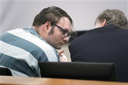 In this Tuesday, June 4, 2019 photo, Dakota Reed consults with his attorney before he is sentenced to a year in jail at Snohomish County Courthouse in Everett, Wash. Reed discussed plans on Facebook for a mass shooting at a synagogue, police in Washington used a new law to quickly seize his 12 firearms, long before he was convicted of any crime.