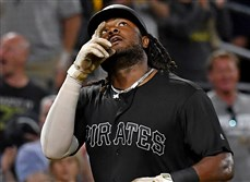 Pirates first baseman Josh Bell heads home after hitting his 32nd home run of the season in the seventh inning against the Reds Saturday, Aug. 24, 2019, at PNC Park.